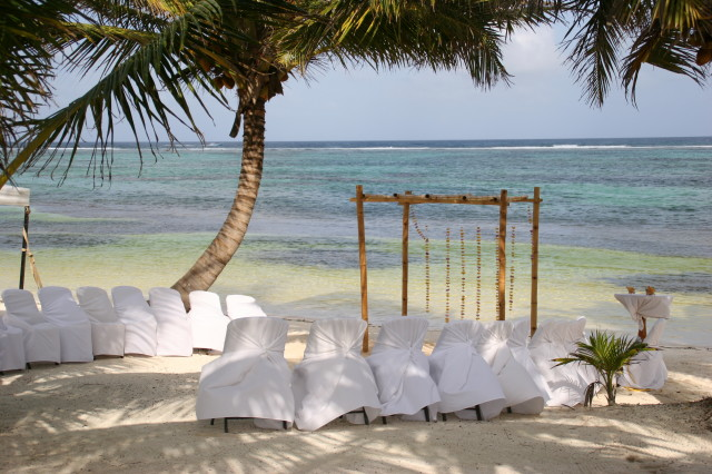Beach wedding in Belize with planner romantictravelbelize.com