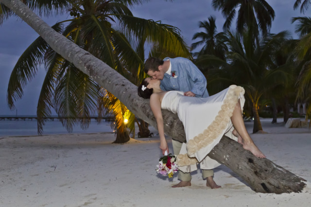 Wedding on the beach in Belize with wedding photographer Zapata and wedding planner romantictravelbelize.com