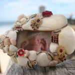 Maddie the Model in a super cute Fish Frame covered in red vintage jewelry, shells and coral
