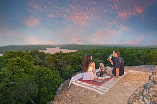 sunset on mayan temple in Belize with Belize wedding planner romantictravelbelize.com